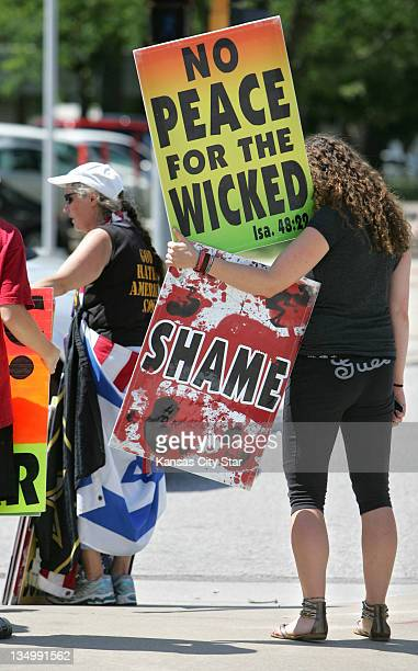 Megan PhelpsRoper right the granddaughter of fundamentalist preacher Fred Phelps of the Westboro Baptist Church in Topeka Kansas picketed outside the...