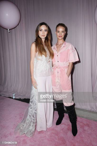 Megan Pormer and Rosie HuntingtonWhiteley attend Patrick Ta Beauty Launch on April 4 2019 in Los Angeles California