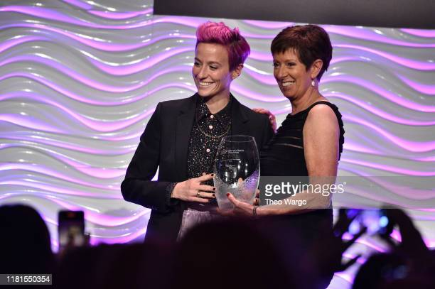 Megan Rapinoe accepts her WSF Sportswoman Of The Year Award from Muffet McGraw at The Women in Sports Foundation 40th Annual Salute to Women in...