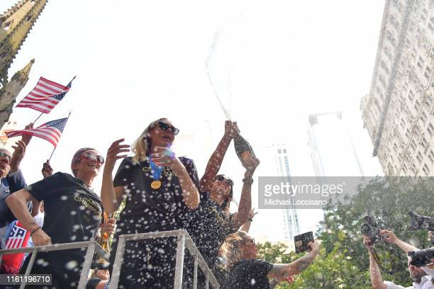 Megan Rapinoe Allie Long and Alex Morgan celebrate while riding on a float during The US Women's National Soccer Team Victory Parade and City Hall...