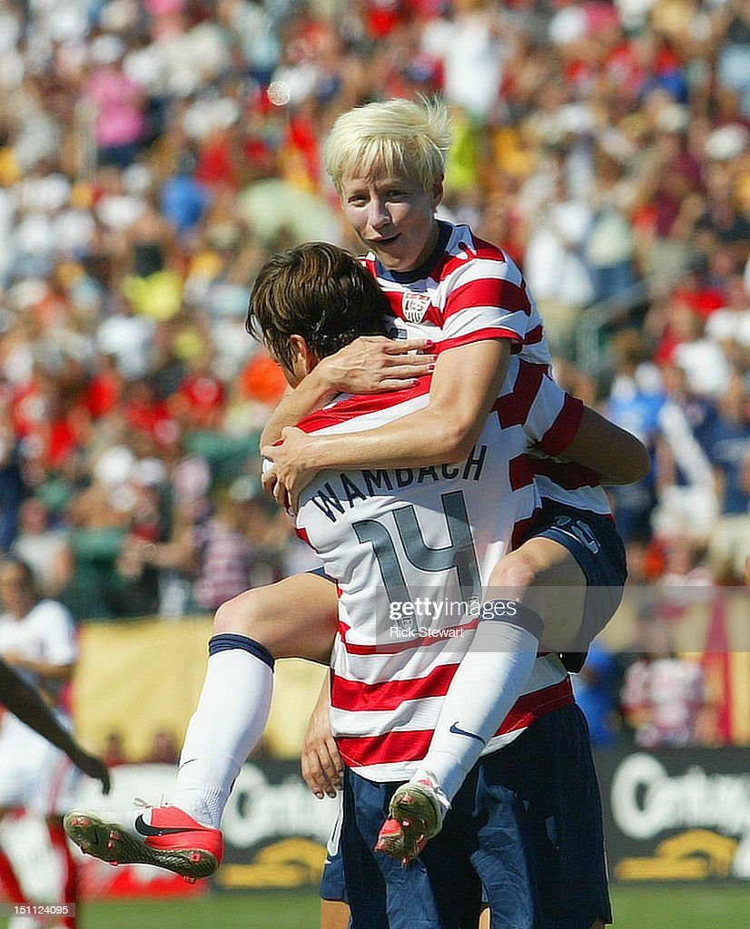 Megan Rapinoe #15 and Abby Wambach #14 of the United States Womens National Team celebrate Wambach's second goal of the first half against Costa Rica during their friendly match at Sahlen's Stadium on September 1, 2012 in Rochester, New York. The US won 8-0.