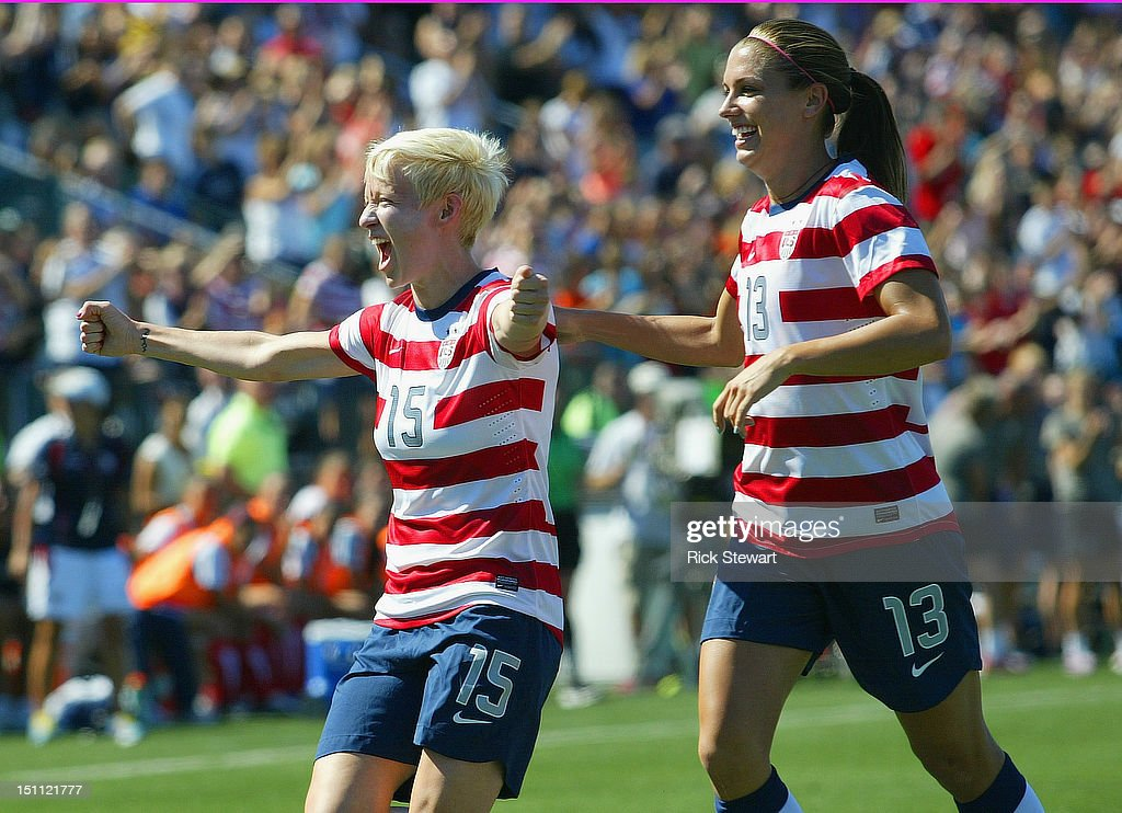 Megan Rapinoe #15 and Alex Morgan #13 of the United States Womens National team celebrate Rapinoe's first goal against Costa Rica during their friendly match at Sahlen's Stadium on September 1, 2012 in Rochester, New York. The US won 8-0.