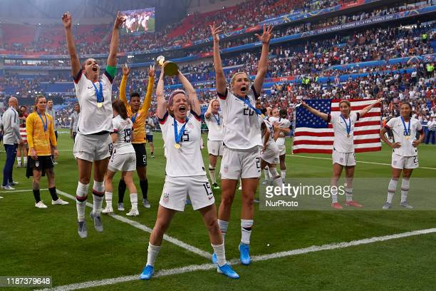 Megan Rapinoe and Alex Morgan of United States celebrate whit her teammates after winning the 2019 FIFA Women's World Cup France Final match between...