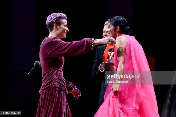 Megan Rapinoe and Ali Krieger embrace onstage at the 2019 Glamour Women Of The Year Awards at Alice Tully Hall on November 11 2019 in New York City