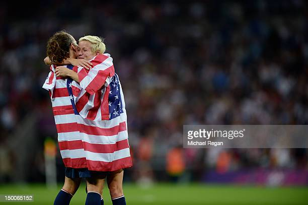 Megan Rapinoe and Lauren Cheney of the United States celebrate with the American flag after defeating Japan by a score of 21 to win the Women's...