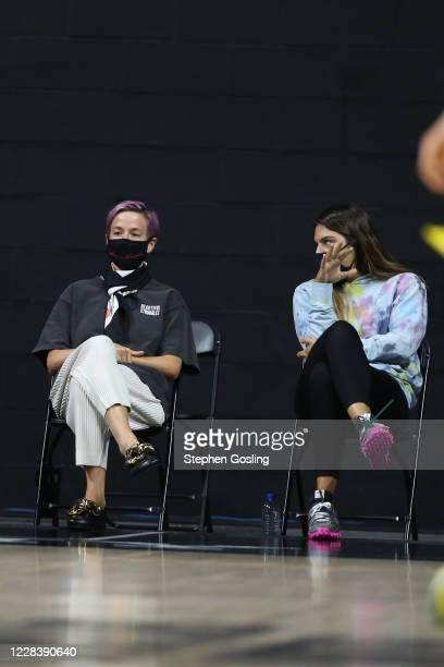 Megan Rapinoe and Marta Xargay watch the game between the Seattle Storm and Minnesota Lynx on September 6 2020 at Feld Entertainment Center in...