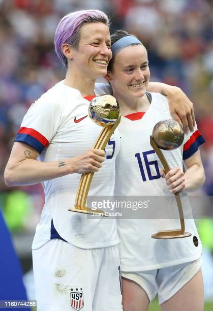 Megan Rapinoe and Rose Lavelle of USA pose with their respective trophies during the trophy ceremony following the 2019 FIFA Women's World Cup France...
