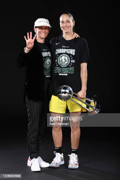 Megan Rapinoe and Sue Bird of the Seattle Storm poses for a portrait with the WNBA Championship Trophy after winning Game 3 of the 2020 WNBA Finals...