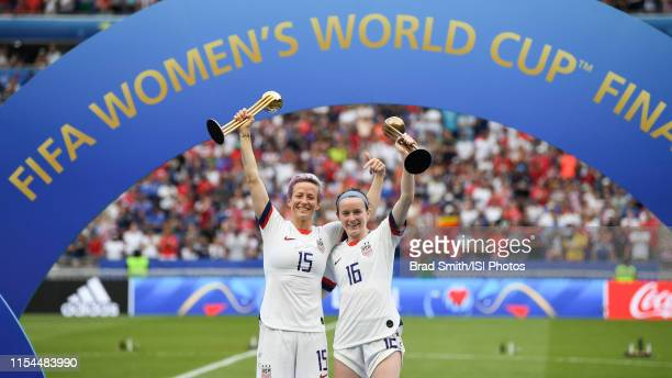 Megan Rapinoe and teammate Rose Lavelle of the United States celebrate with the golden and bronze ball trophies after the 2019 FIFA Women's World Cup...