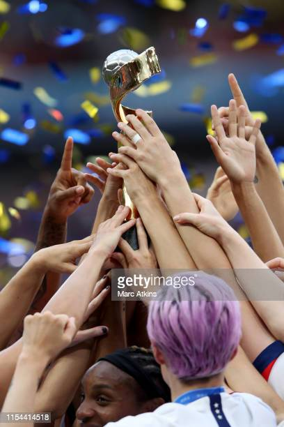 Megan Rapinoe and USA players celebrate as they lift the trophy during the 2019 FIFA Women's World Cup France Final match between The United States...