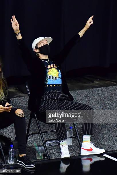 Megan Rapinoe celebrates after Alysha Clark of the Seattle Storm scores a three point basket in the third quarter of Game 3 of the WNBA Finals...