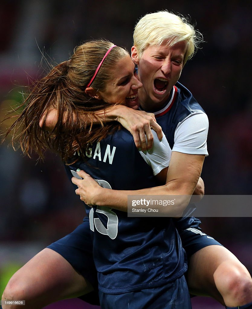Megan Rapinoe celebrates with Alex Morgan of the United States after scoring during the Women's Football Semi Final match between Canada and USA, on Day 10 of the London 2012 Olympic Games at Old Trafford on August 6, 2012 in Manchester, England.