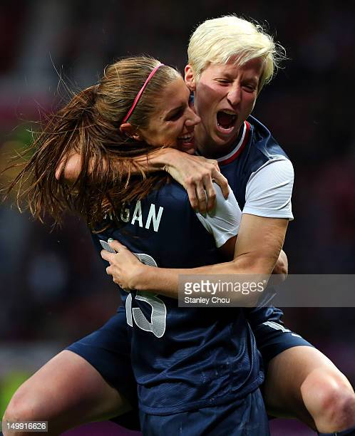 Megan Rapinoe celebrates with Alex Morgan of the United States after scoring during the Women's Football Semi Final match between Canada and USA, on...
