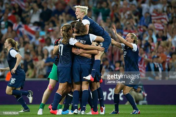 Megan Rapinoe Heather Mitts and the United States women's soccer team celebrate after defeating Japan by a score of 21 to win the Women's Football...