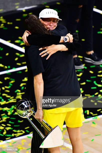 Megan Rapinoe hugs Sue Bird of the Seattle Storm after the Storm defeated the Las Vegas Aces in Game 3 of the WNBA Finals to win the championship at...