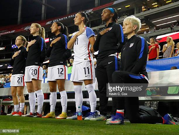 Megan Rapinoe kneels during the National Anthem prior to the match between the United States and the Netherlands at Georgia Dome on September 18,...