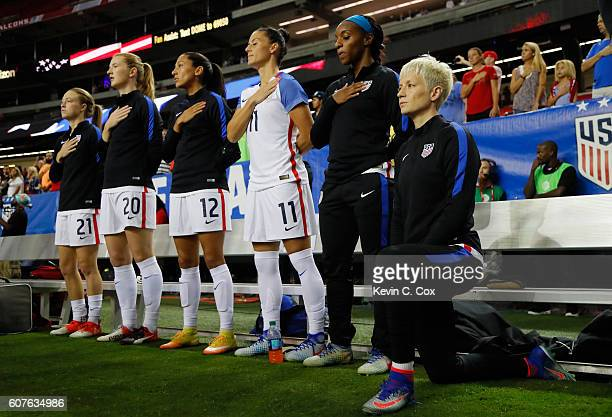 Megan Rapinoe kneels during the National Anthem prior to the match between the United States and the Netherlands at Georgia Dome on September 18 2016...