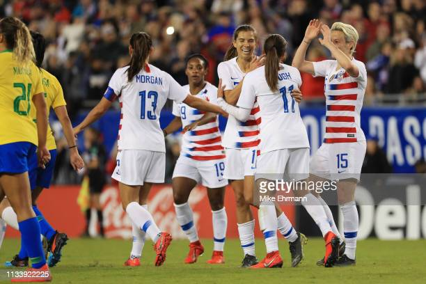 Megan Rapinoe Mallory Pugh and Alex Morgan celebrate with Tobin Heath of USA after a goal against Brazil in the first half during the She Believes...