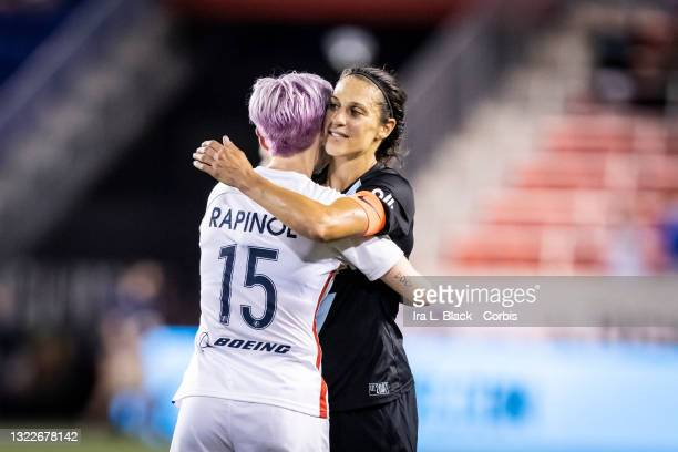 Megan Rapinoe of OL Reign and Carli Lloyd of NJ/NY Gotham FC share a hug after the match at Red Bull Arena on June 5, 2021 in Harrison, New Jersey.