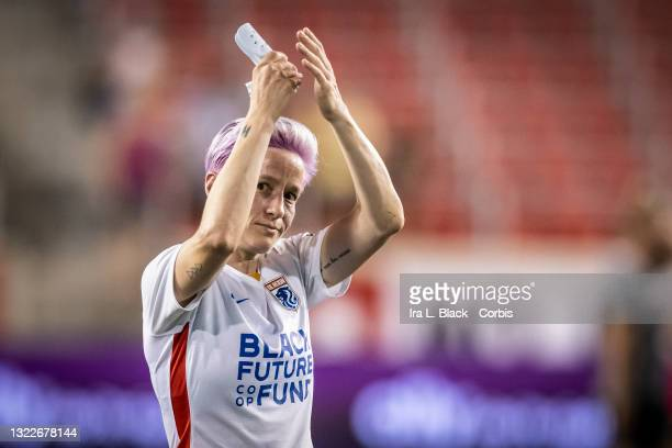 Megan Rapinoe of OL Reign claps to fans after the match against NJ/NY Gotham FC at Red Bull Arena on June 5, 2021 in Harrison, New Jersey.