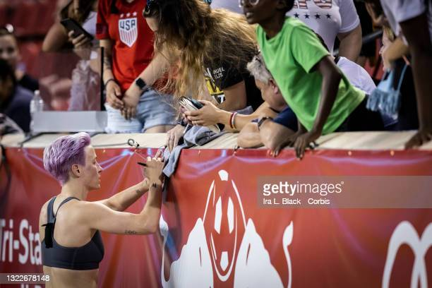Megan Rapinoe of OL Reign signs autographs for fans after the match against NJ/NY Gotham FC at Red Bull Arena on June 5, 2021 in Harrison, New Jersey.