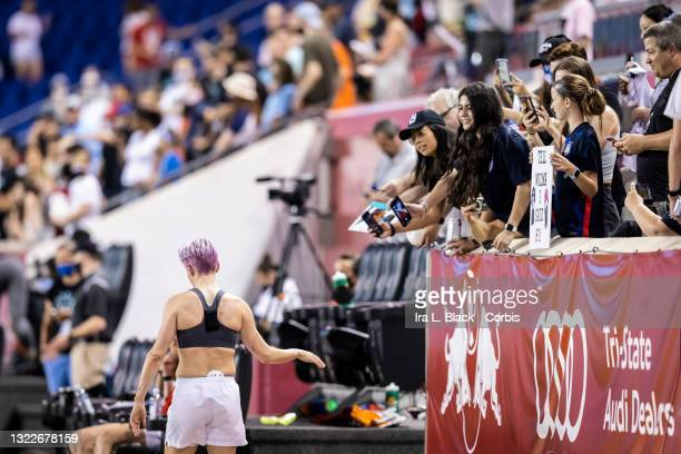 Megan Rapinoe of OL Reign walks past fans that are asking for autographs or asking for a photo after the match against NJ/NY Gotham FC at Red Bull...