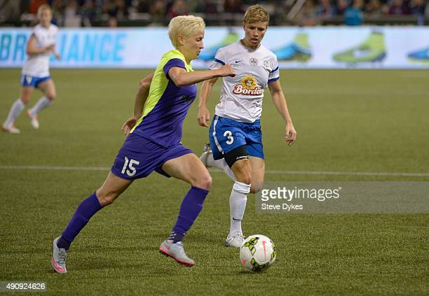Megan Rapinoe of Seattle Reign FC and Rebecca Moros of FC Kansas City battle for a ball during the second half of the game at Providence Park on...
