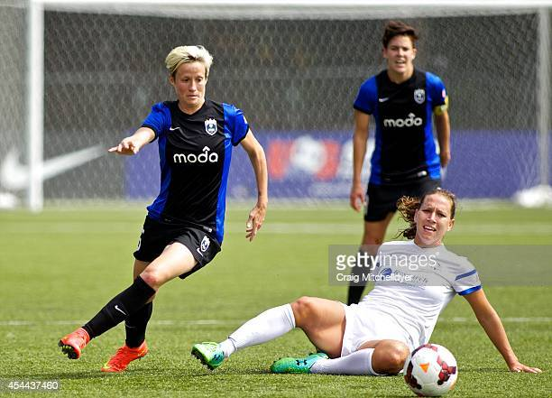 Megan Rapinoe of Seattle Reign FC dribbles past Lauren Holiday of FC Kansas City in the first half of the National Women's Soccer League Championship...