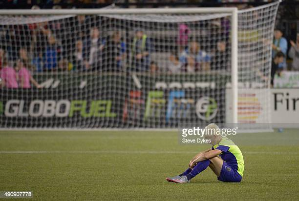 Megan Rapinoe of Seattle Reign FC sits on the pitch after the Seattle Reign FC lost the NWSL Championship to the FC Kansas City by a score of 10 at...