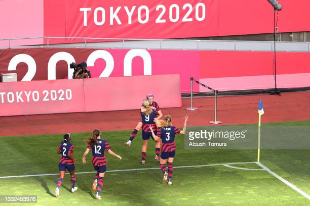 Megan Rapinoe of Team United States celebrates with Lindsey Horan and Samantha Mewis after scoring their side's first goal during the Women's Bronze...