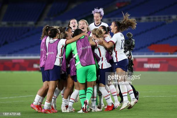 Megan Rapinoe of Team United States celebrates with Rose Lavelle and team mates following their team's victory in the penalty shoot out during the...