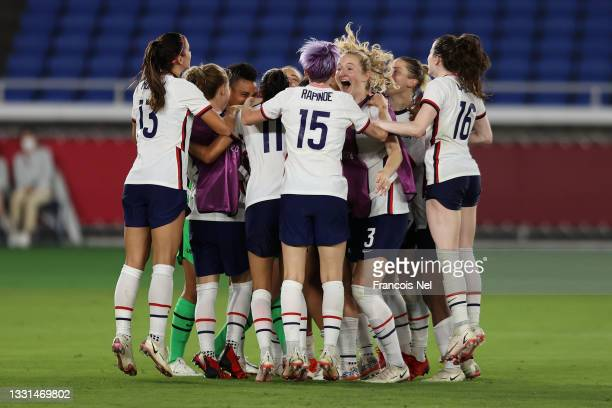 Megan Rapinoe of Team United States celebrates with Samantha Mewis and team mates following their team's victory in the penalty shoot out during the...
