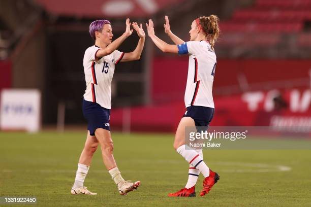 Megan Rapinoe of Team United States interacts with Becky Sauerbrunn of Team United States following defeat in the Women's Semi-Final match between...