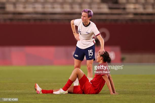 Megan Rapinoe of Team United States interacts with Christine Sinclair of Team Canada after the Women's Semi-Final match between USA and Canada on day...