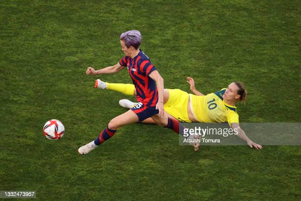 Megan Rapinoe of Team United States is challenged by Emily Van Egmond of Team Australia during the Women's Bronze Medal match between United States...