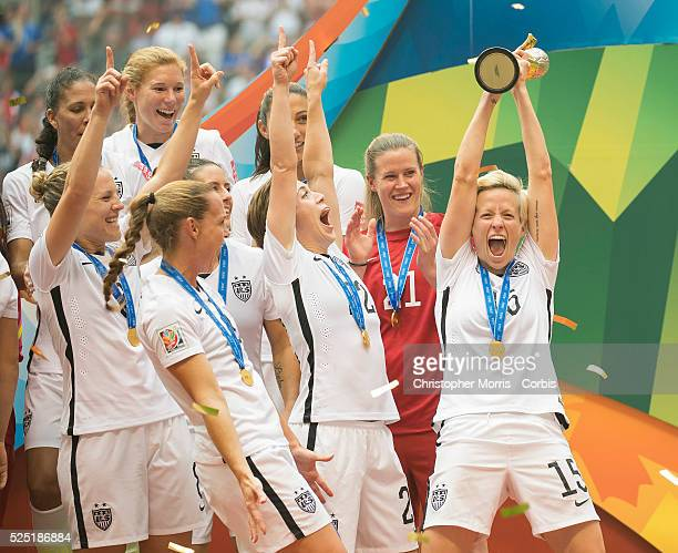 Megan Rapinoe of team USA hoists high the FIFA 2015 World Cup trophy while celebrating with team USA's victory over Japan during 2015 women's World...