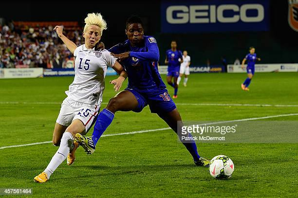 Megan Rapinoe of the United States battles for the ball against Roselord Borgella of Haiti in the first half during the 2014 CONCACAF Women's...
