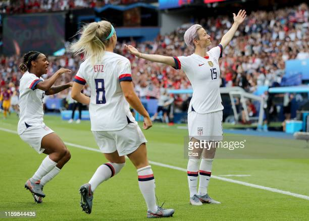 Megan Rapinoe of the United States celebrates her goal as teammates Crystal Dunn and Julie Ertz of the United States join her in the first half...