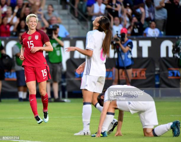 Megan Rapinoe of the United States celebrates her goal for a 10 lead in front of Rumi Utsugi and Aya Sameshima during the first half of the 2017...