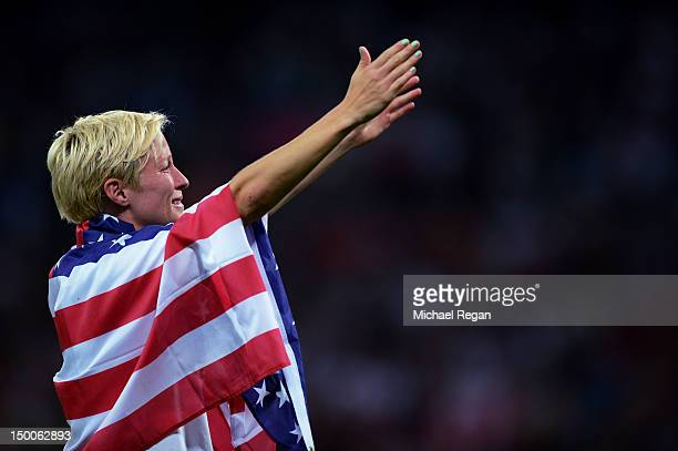Megan Rapinoe of the United States celebrates with the American flag after defeating Japan by a score of 2-1 to win the Women's Football gold medal...