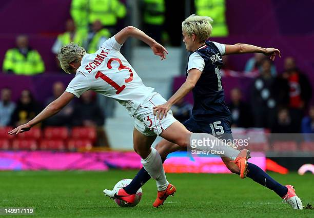 Megan Rapinoe of the United States clashes with Sophie Schmidt of Canada during the Women's Football Semi Final match between Canada and USA, on Day...