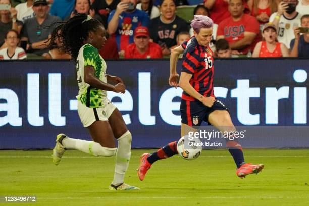 Megan Rapinoe of the United States controls the ball against Michelle Alozie of Nigeria during the second half of their WNT Summer Series game at Q2...