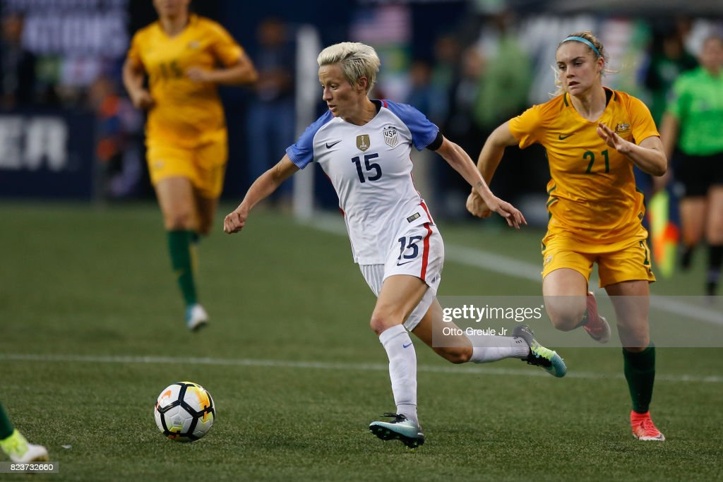 Megan Rapinoe #15 of the United States dribbles against Ellie Carpenter #21 of Australia during the 2017 Tournament of Nations at CenturyLink Field on July 27, 2017 in Seattle, Washington.