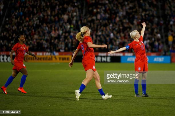 Megan Rapinoe of the United States gestures to the crowd to celebrate her goal as Crystal Dunn and Lindsey Horan look on against Australia during the...