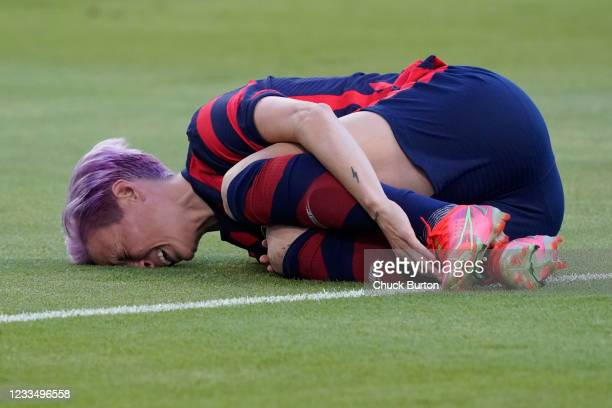 Megan Rapinoe of the United States grabs her ankle in pain during the first half of their WNT Summer Series game against Nigeria at Q2 Stadium on...