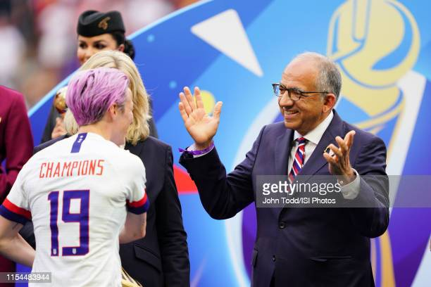 Megan Rapinoe of the United States is greeted by US Soccer president Carlos Cordeiro after the 2019 FIFA Women's World Cup France final match between...