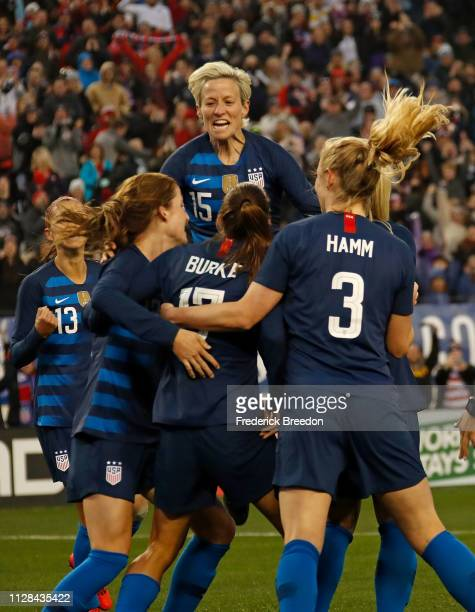 Megan Rapinoe of the United States jumps on top of teammate Tobin Heath in celebration of a goal against England during the second half of the 2019...