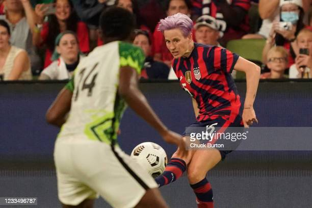 Megan Rapinoe of the United States passes the ball against Chidinma Okeke of Nigeria during the second half of their WNT Summer Series game at Q2...