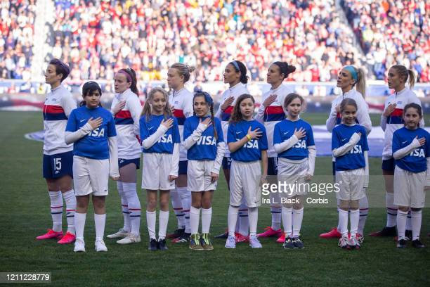 Megan Rapinoe of the United States stands at attention with her hands at her sides during the playing of the United States National Anthem at the...