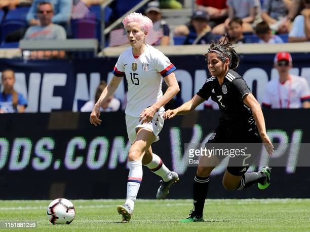 Megan Rapinoe of the United States takes the ball as Kenti Robles of Mexico defends in the first half at Red Bull Arena on May 26 2019 in Harrison...